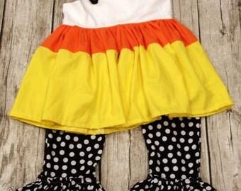candy corn knot top and polka dot ruffled pants