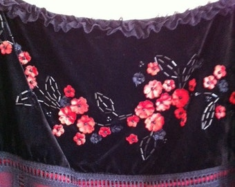 A Vintage Camisole With Beading And Lace Trim