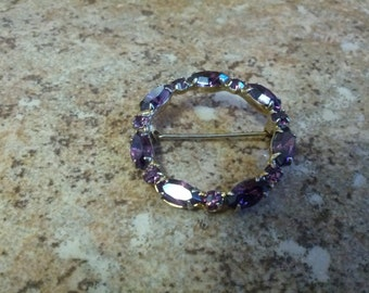 Lovely Amethyst circular brooch in gold tone metal