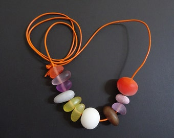 Handmade coloured resin bead necklace on orange leather cord