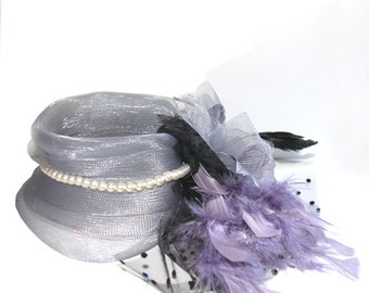 Gray Fascinator with tulle and pearls, accented with feather