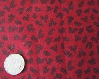 One Yard Black Pine Needles on Dark Red Background     destash 195