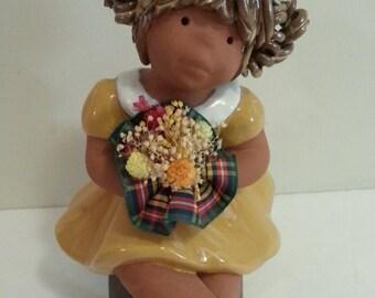 Ceramic Figurine - -Girl Sitting on Stool Holding Flower Bouquet