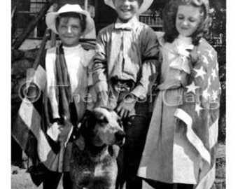 Patriotic children and their mix breed dog,