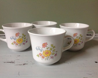 Four vintage Corelle Coffee Cups/Tea Cups Wild Flower Pattern Spring Flowers