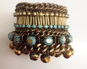 Turquoise Bracelet - turquoise rainstone and gold crystal beads - hand made. coloses:gold antique plated chain. ond of kind.