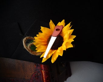 Sunflower boutonniere with a mini saw