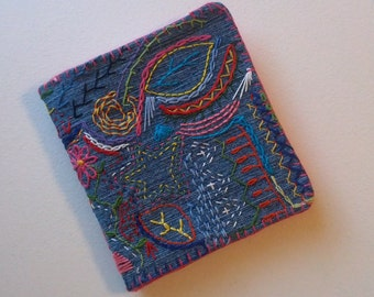 Hand Stitched Denim Needle Book Embellished with Colorful Freestyle Embroidery