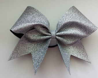 Silver glitter cheer bow. Ask about bulk discounts, color and mascot options.