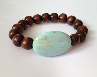 Wood beads bracelet with a dyed turquoise howlite