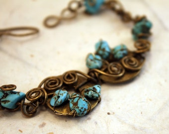 Blue magnesite and brass disk wire wrapped bracelet