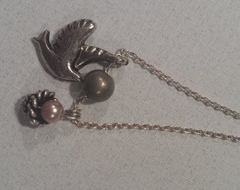 Silver bird with nest and egg charm necklace