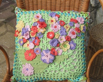 crochetted pillow over with bird and flowers