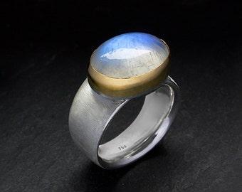 Blue rainbow moonstone ring with gold bezel 18k. Handmade jewelry.