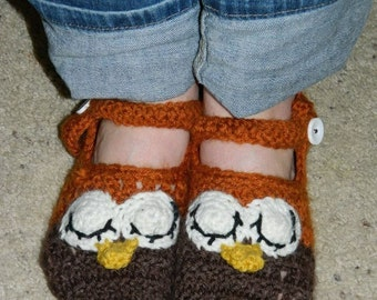 Handmade crocheted owl slippers.