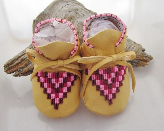Native american beaded baby moccasins and soft soled shoes made of