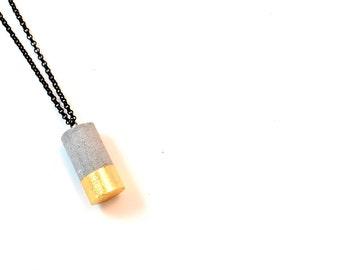 Cylinder Concrete Necklace with dipped gold leafing Modern brutalist jewelry