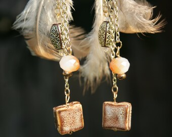 Feather and stone chandelier earrings