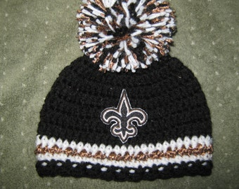 Crochet Beanie Baby Hat - Embroidered Logo (New Orleans Saints colors) Black, Gold and White with Saints logo and large pom pom