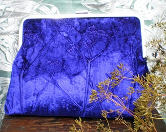A beautiful kisslock clutch bag in an embossed iridescent velvet botanical cow parsley design