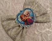 Ice Sisters of Frozen, Anna and Elsa on White whimsy Snow Fabric Hair Bow Gift Accessory