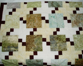 Tan and Green Hand quilted lap quilt in pixelated design