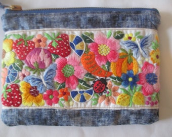 Blue and white change purse with an embroidered floral strip handmade zipper pouch with lining