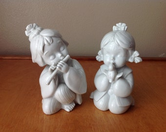 Two White Porcelain Asian Children with Bird and Flute Vintage Children at Play