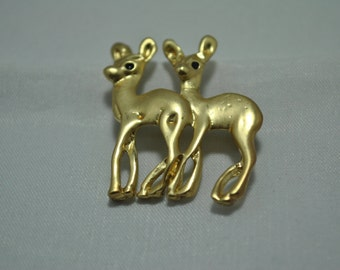 Vintage gold tone brooch of 2 young deer with spots.