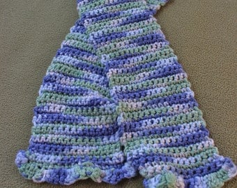 crochet scarf in variegated blues and green with ruffled ends