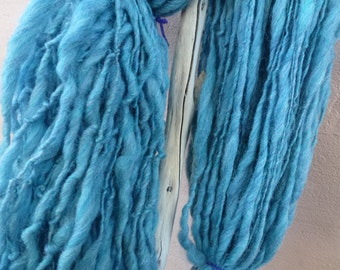 300 grams hand spun  thick n thin merino yarn.