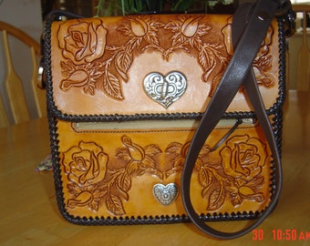 Hand Tooled Leather Bag, with an adjustable shoulder strap