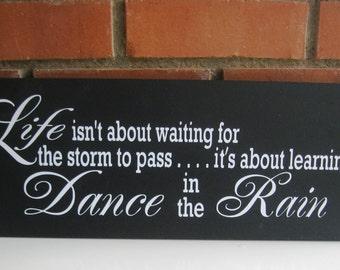 Dance in the Rain Sign