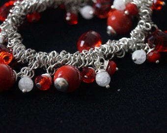 Bracelet with charms to red pearls