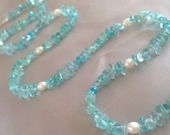 Elegant blue-green apatite gemstone necklace with freshwater pearls and sterling silver toggle clasp.