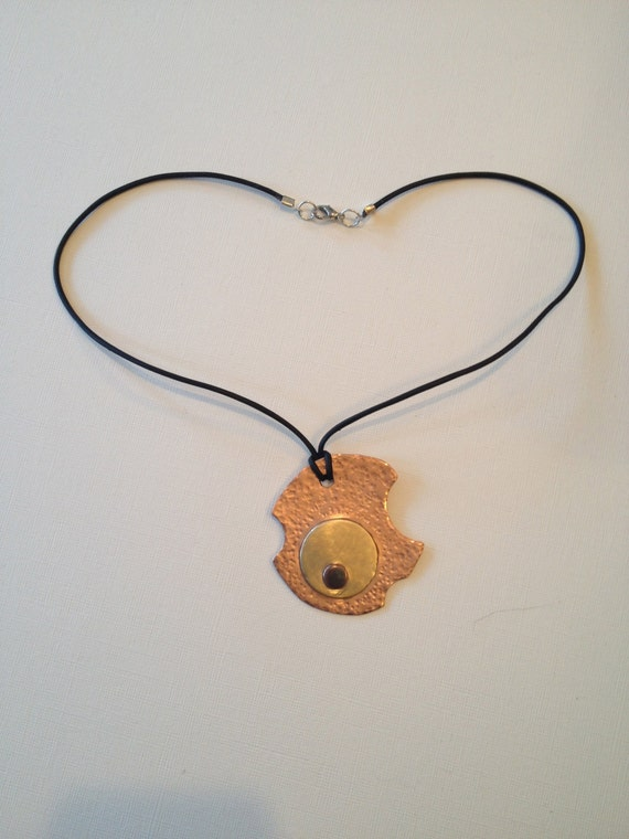 Copper, Brass and antique-look copper asymmetric round pendant necklace.