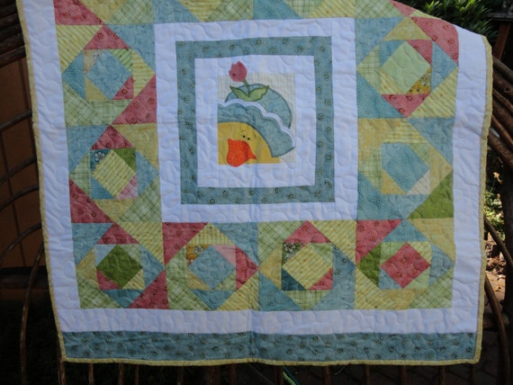 Unisex baby quilt made of nancy halvorsen fabrics 32 x for Unisex baby fabric