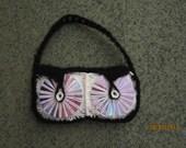 Handbag made of dvds, crochet
