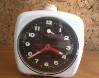 white metal alarm clock made in germany colors white