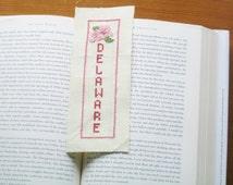 Cross stitch bookmark needlepoint needlecraft embroidery flower peach blossom red green pink Delaware literature bookworm book Christmas