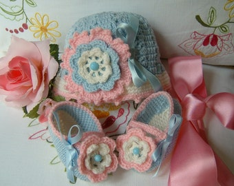 Crocheted hat and booties handmade 100% wool in colours blue, white and pink. Crochet baby winter fashion