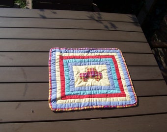 Small wall hanging,  blue, yellow green and red, car detail, Table mat.   Hand quilted, applique. Ideal gift for a boy