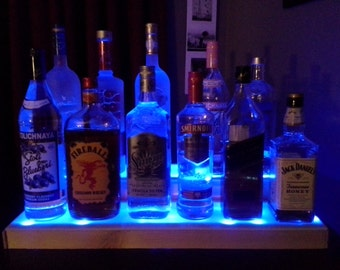 illuminated bottle display. Handcrafted mini bar.