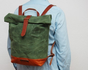waxed rucksack/backpack, green army color, hand waxed , with handles, leather base and  closures