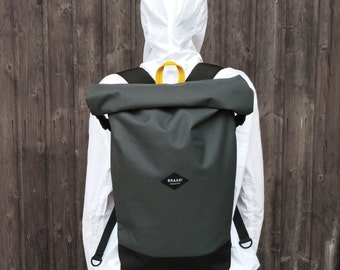 Rolltop gray backpack for urban cycling, daily commuting and travels.