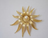 Signed Boucher gold and pearl starburst sunflower brooch