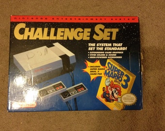 Nintendo entertainment system NES challenge set with box mario 3 controllers (Complete with all cords)