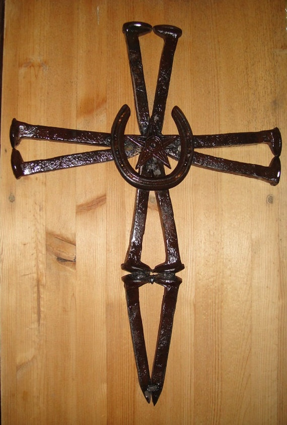 Cross made out of railroad spikes a horseshoe by for Horseshoe crafts for sale