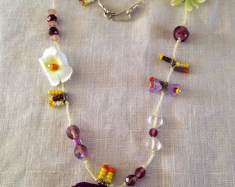 purple and yellow bead and flower necklace