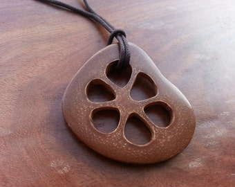 seed pod slice pendant with brown cord